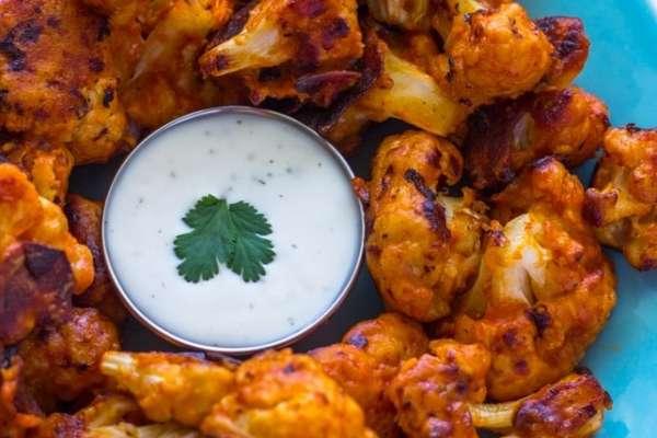 soft, crispy, cauliflower buffalo wings with creamy dipping sauce