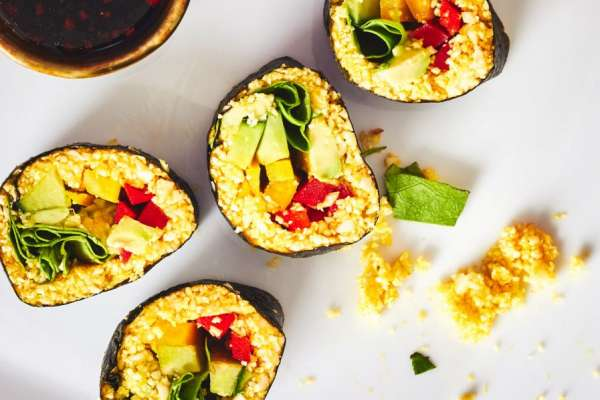 raw cauliflower turmeric sushi in reds and greens