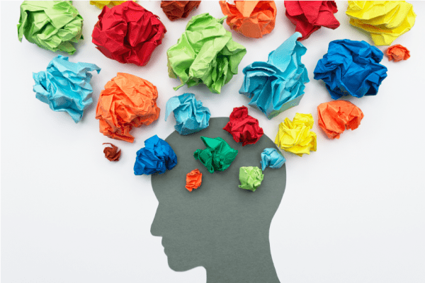 image of brain with colored bundles of tissue paper representing thoughts and emotions