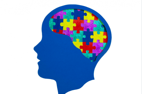 clipart silhouette of human head with multi-colored puzzle pieces in brain region