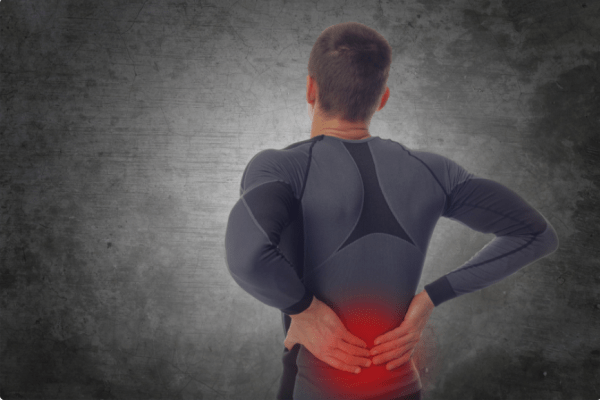 man facing away from viewer, lower back glowing red with pain