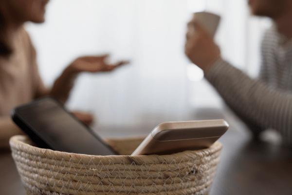 phones sitting in basket for digital detox