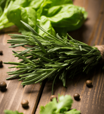 image of herbs lying on wood table