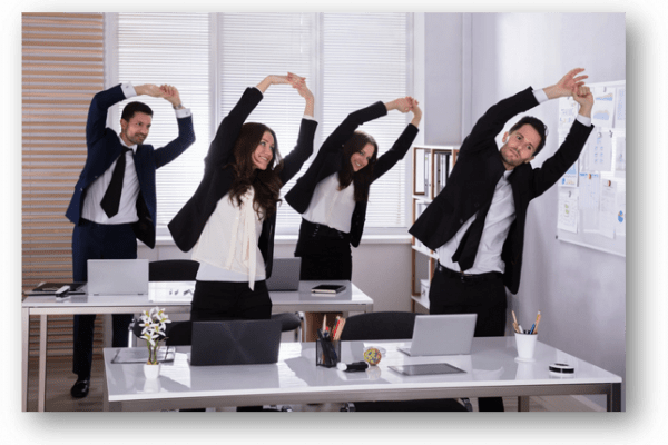 employees stretching together in office