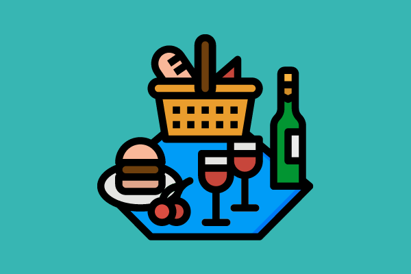 hamburger, wine, and bread set out on a picnic blanket