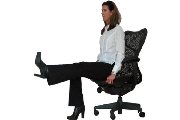 woman seated at desk chair, one leg extended