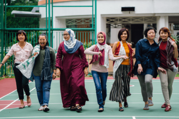 women walking down the street in diverse garb of different ethnicities
